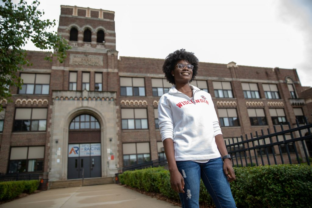 Sarah Akakpo stands in front of her high school