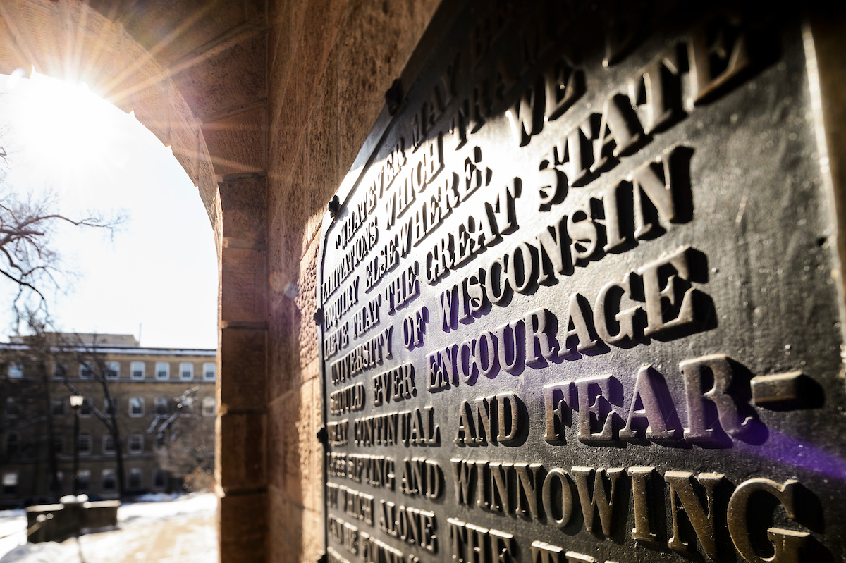 winter-morning sunlight shines upon a close-up view of the letters on the