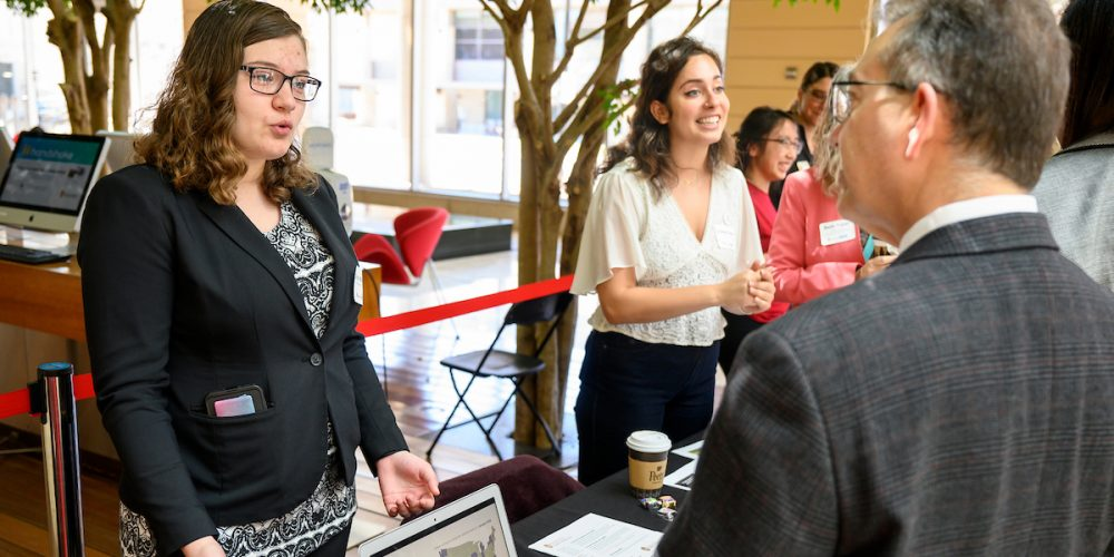 UW student Skylyn Worzalla speaks with William Karpus, dean of the graduate school, at an info session during the University of Wisconsin-Madison and American Family Insurance Partnership Celebration Event held in the Discovery Building of the University of Wisconsin-Madison on April 19, 2019.