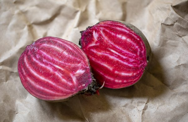 A beet from one of the Goldman Lab's experimental breeding lines, sliced in half
